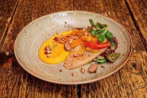 Seafood starter with orange slices