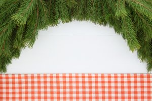 Frame of pine branches, tablecloth.