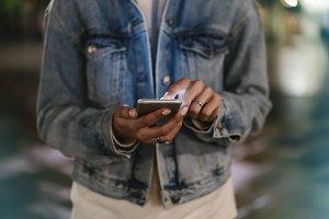 Girl enjoys smart phone in the city