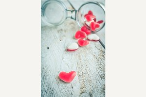 Red heart shape candy in a glass jar