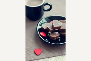 Cup of coffee with chocolate sweets