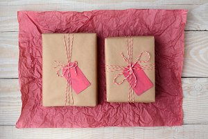 Two Gifts on Red Tissue Paper