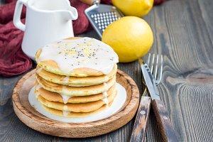 Homemade lemon and chia seed pancakes with citrus glaze, horizontal, copy space