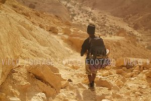 Traveler with Hiking Backpack in the Desert