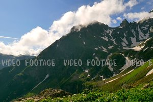 High Snowy Mountains and Green Hills, Clouds Timelapse. Kavkaz region