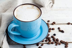 cup with cappuccino on a white