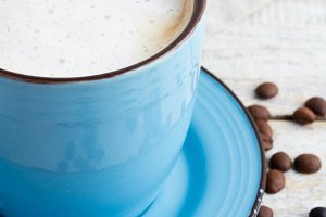 cappuccino in blue cup on a white