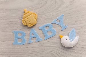 word baby cut out of blue felt