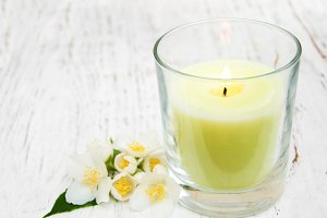 Candle and jasmine flowers