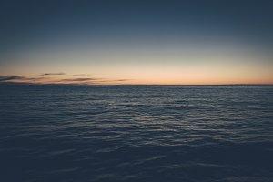 Sunset over Ocean and Dark Water