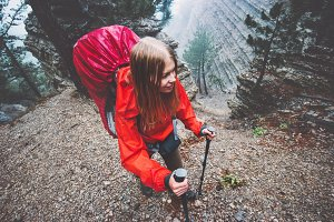 Woman hiking in foggy mountains