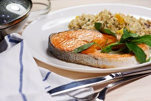 Baked salmon steak with basil