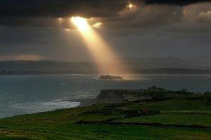 Magical sunbeam over the island