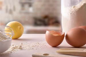 Fresh eggs flour and lemon front