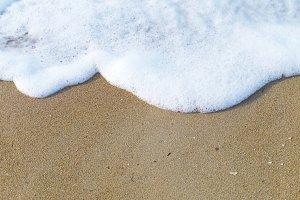 Sea foam on coast.
