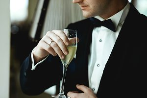 Married man holds a glass