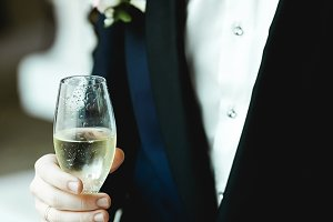 Man in tuxedo holds a champagne