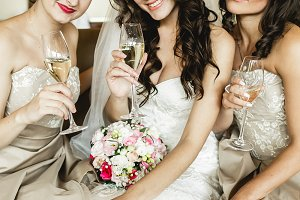 Smiling bride and bridesmaids