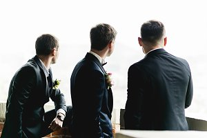 Groom and groomsmen on the balcony