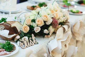 Wooden lettering behind a bouquet