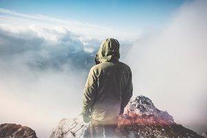 Traveler standing on mountain summit