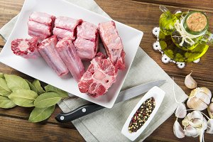 Oxtail and with olive oil and ingredients to cook it