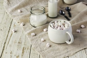 white cup with cocoa and marshmallows, selective focus