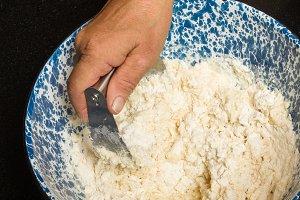Kneading flour into dough