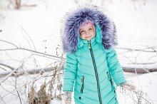 Little girl smiles in winter.