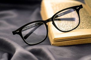 reading Eyeglasses with opened book