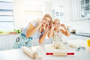 Mother and daughter playing with dough