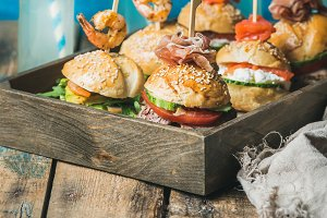 Homemade burgers in wooden tray