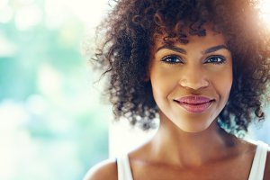 Smiling young black woman in sunshine