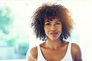 Beautiful young black woman with frizzy Afro hair