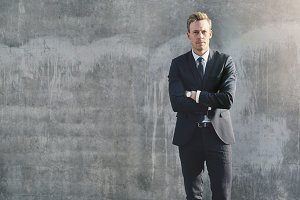 Male in formal suit posing being confident