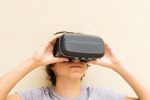 Teenager in VR glasses