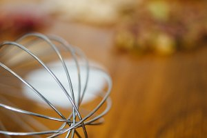 Close-up of egg whisk on table