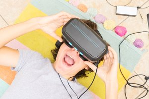 Teenager wearing VR glasses