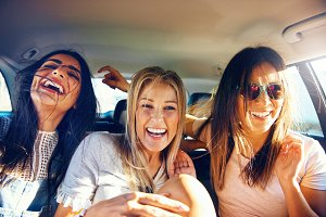 Three vivacious girlfriends on a road trip