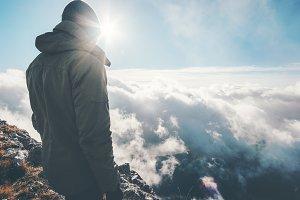 Traveler on mountain summit