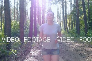 Runner woman running in park exercising outdoors fitness tracker wearable technology girl running in the woods in the open air outdoors playing sports healthy lifestyle jogging nature trees listening to music