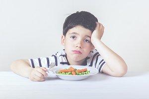 Sad boy with food