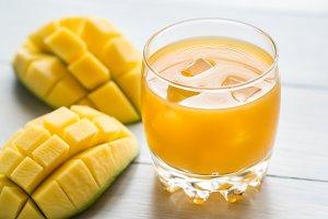 Mango juice on the wooden table