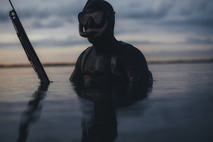 Spearfishing diver in a lake