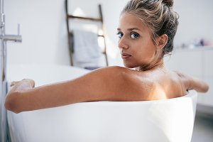 Beautiful young woman in bathtub