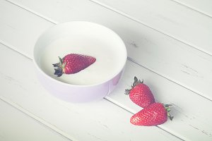 Strawberries in a bowl with yogurt