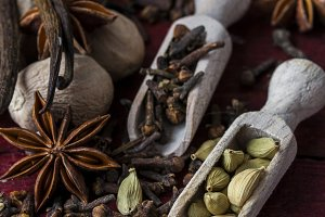 fragrant spices in wooden scoops
