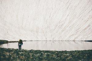Traveler enjoying lake and glacier