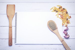 Open recipe book with blank pages
