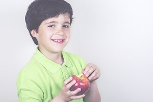 Smiling child with an apple
